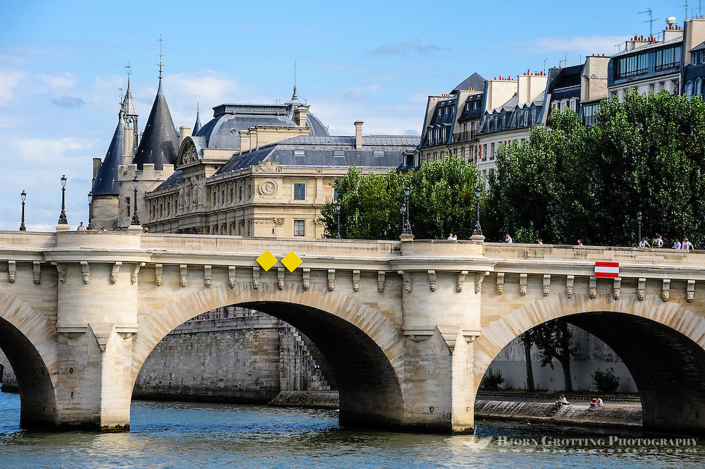 Paris, France. View from a boat on the river Seine. The Palais de Justice is located in the Île de la Cité, built on the site of the former royal palace of Saint Louis. Pont Neuf in the foreground.