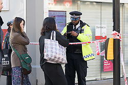 © Licensed to London News Pictures. 22/05/2018. London, UK. Police speak to local residents at the crime scene cordon in Upper Street, Islington this morning. Police were called at approximately 18:30hrs on Monday, 21 May to reports of a man suffering stab injuries after being attacked in Upper Street.<br /> Officers and London Ambulance Service attended. The man was pronounced dead at the scene. Photo credit: Vickie Flores/LNP