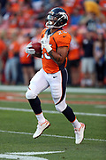 Denver Broncos running back Devontae Booker (23) runs with the ball while warming up before the 2016 NFL week 1 regular season football game against the Carolina Panthers on Thursday, Sept. 8, 2016 in Denver. The Broncos won the game 21-20. (©Paul Anthony Spinelli)