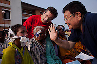 Patches are taken off less than a day after surgery. Dr Sanduk Ruit (r) examines Chameli watched on by Professor Geoff Tabin from Moran Eye Centre Utah.