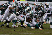 PHILADELPHIA - NOVEMBER 18: The Philadelphia Eagles defense tries to take down Jesse Chatham #28 of the Miami Dolphins during the game on November 18, 2007 at Lincoln Financial Field in Philadelphia, Pennsylvania.
