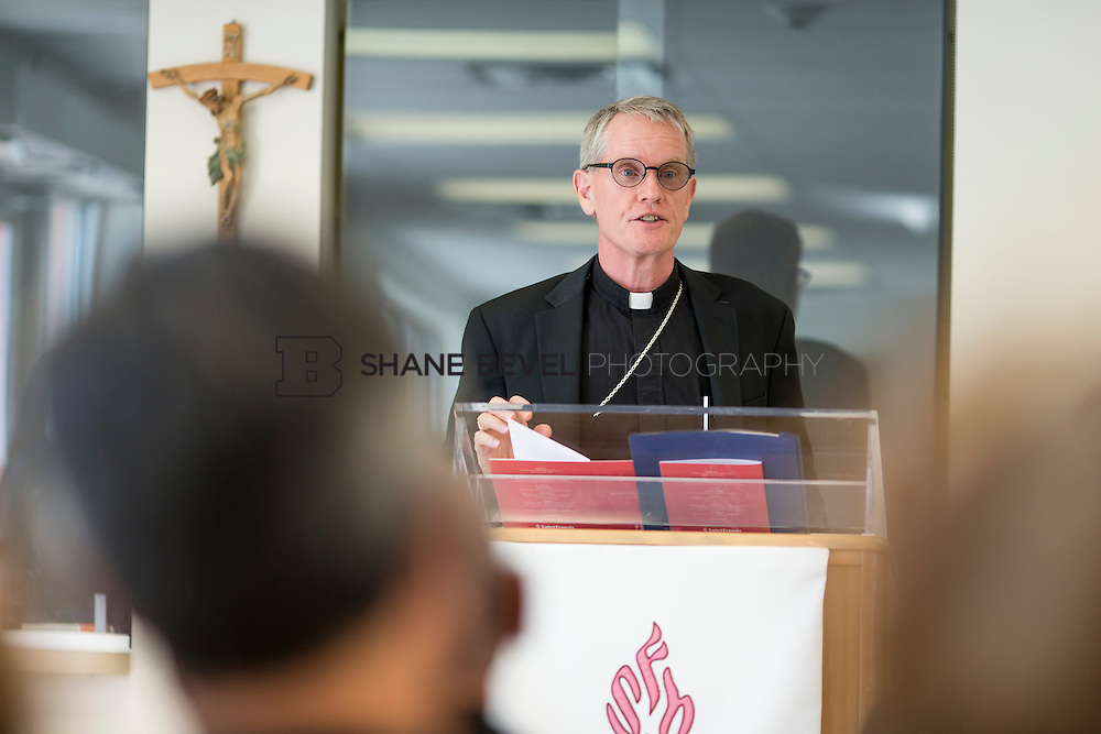 9/29/16 4:07:22 PM --  Bishop David Konderla blesses the newly remodeled Xavier Clinic in east Tulsa. <br /> <br /> Photo by Shane Bevel