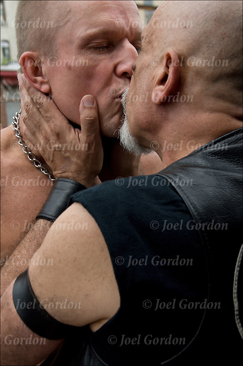 "Folson Street East S&M Fair in New York City. Master / Slave Cathartic Flogging scene.The flogging brings out a release of emotions usually by a crying. Hugging is the ""aftercare"" where the slave feels safe and protected.."