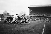 K C Briscoe of New Zealand passes the ball out from a scrum, ..Irish Rugby Football Union, Ireland v New Zealand, Tour Match, Landsdowne Road, Dublin, Ireland, Saturday 7th December, 1963,.7.12.1963, 12.7.1963,..Referee- H Keenen, Rugby Football Union, ..Score- Ireland 5 - 6 New Zealand, ..Irish Team, ..T J Kiernan, Wearing number 15 Irish jersey, Full Back, Cork Constitution Rugby Football Club, Cork, Ireland,..J Fortune, Wearing number 14 Irish jersey, Right Wing, Clontarf Rugby Football Club, Dublin, Ireland,..P J Casey, Wearing number 13 Irish jersey, Right Centre, University College Dublin Rugby Football Club, Dublin, Ireland, ..J C Walsh,  Wearing number 12 Irish jersey, Left Centre, University college Cork Football Club, Cork, Ireland,..A T A Duggan, Wearing number 11 Irish jersey, Left Wing, Landsdowne Rugby Football Club, Dublin, Ireland,..M A English, Wearing number 10 Irish jersey, Stand Off, Landsdowne Rugby Football Club, Dublin, Ireland, ..J C Kelly, Wearing number 9 Irish jersey, Captain of the Irish team, Scrum Half, University College Dublin Rugby Football Club, Dublin, Ireland,..P J Dwyer, Wearing number 1 Irish jersey, Forward, University College Dublin Rugby Football Club, Dublin, Ireland, ..A R Dawson, Wearing number 2 Irish jersey, Forward, Wanderers Rugby Football Club, Dublin, Ireland, ..R J McLoughlin, Wearing number 3 Irish jersey, Forward, Gosforth Rugby Football Club, Newcastle, England, ..W J McBride, Wearing number 4 Irish jersey, Forward, Ballymena Rugby Football Club, Antrim, Northern Ireland,..W A Mulcahy, Wearing number 5 Irish jersey, Forward, Bective Rangers Rugby Football Club, Dublin, Ireland,  ..E P McGuire, Wearing number 6 Irish jersey, Forward, University college Galway Football Club, Galway, Ireland,  ..P J A O' Sullivan, Wearing  Number 8 Irish jersey, Forward, Galwegians Rugby Football Club, Galway, Ireland,..N A Murphy, Wearing number 7 Irish jersey, Forward, Cork Constitution Rugby Football Club, Cork, Ireland,..New Zea