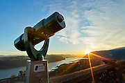 A coin operated telescope is seen at sunrise at the The Vista House that overlooks the Columbia River Gorge in Corbett, Oregon.