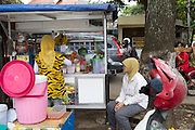 Nur Khayati, 24, making a fruit smoothie for a customer.<br /> <br /> Nur was working in a restaurant when she downloaded the Usaha Wanita app. She wasn't planning to go into business then but the stories and advice about the need for women to be independent inspired her so much that she decided to invest her savings in setting up a juice stall.<br /> <br /> Her fruit is purchased daily and the juices are freshly prepared in front of the customer. <br /> <br /> Her business is just four months old but is already thriving. She has been able to give her parents 6 million rupiah, which they are investing in land to increase the size of their fruit farm. <br /> <br /> She is also opening a new booth in another part of town in two weeks time.