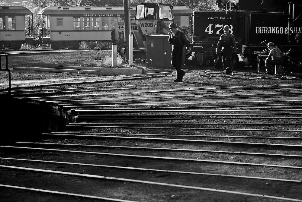 Workers in the D&SRR train yard, Durango, Colorado.