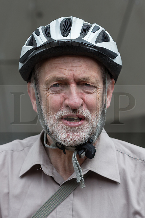 © Licensed to London News Pictures. 14/05/2016. LONDON, UK. JEREMY CORBYN joins demonstrators from a number of Islington housing groups at the start of a protest and march along Holloway Road, ending outside Holloway prison to protest against the housing bill and closure of Holloway prison. Protesters accuse the government of selling off the publicly owned inner city prison to private property developers, accelerating gentrification and worsening the UK's housing crisis. MP for Islington North, Jeremy Corbyn joined protesters and spoke of his support at the start of the demonstration.  Photo credit: Vickie Flores/LNP/2016. LONDON, UK. JEREMY CORBYN leaving after he joins demonstrators from a number of Islington housing groups at the start of a protest and march along Holloway Road, ending outside Holloway prison to protest against the housing bill and closure of Holloway prison. Protesters accuse the government of selling off the publicly owned inner city prison to private property developers, accelerating gentrification and worsening the UK's housing crisis. MP for Islington North, Jeremy Corbyn joined protesters and spoke of his support at the start of the demonstration.  Photo credit: Vickie Flores/LNP