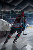 KELOWNA, CANADA - JANUARY 17: Kyle Topping #24  of the Kelowna Rockets skates through the dragon as he enters the ice against the Lethbridge Hurricanes on January 17, 2018 at Prospera Place in Kelowna, British Columbia, Canada.  (Photo by Marissa Baecker/Shoot the Breeze)  *** Local Caption ***