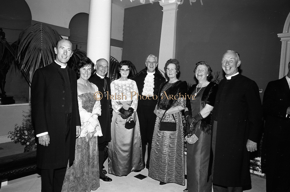 Inauguration of Eamon de Valera as President. Atending a reception in Dublin Castle for the Inauguration of President de Valera were (l-r) Rev. W. O'Neill, Moderator, Dublin/Munster Presbyteries; Mrs. O'Neill; Very Rev. J.W. Armstrong, Dean of St. Patrick's Cathedral; Mrs. Armstrong; Rt. Rev. Dr. Alfred Martin, Moderator of the General Assembly Presbyterian Church in Ireland; Mrs. Martin; Mrs. V.G. Corkey and her husband, Rev. V.G. Corkey, Chaplain to the Moderator of the General Assembly..25.06.1966