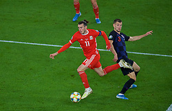 CARDIFF, WALES - Sunday, October 13, 2019: Wales' captain Gareth Bale sprints past Croatia's Borna Barišić during the UEFA Euro 2020 Qualifying Group E match between Wales and Croatia at the Cardiff City Stadium. (Pic by Paul Greenwood/Propaganda)
