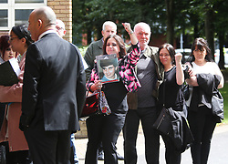 © Licensed to London News Pictures. 09/08/2017. Warrington, UK. Families of those who lost their lives in the Hillsborough disaster arrive at Warrington Magistrates Court. Former West Yorkshire Police Chief Sir Norman Bettison, former police officers Donald Denton and Alan Foster, South Yorkshire Police solicitor Peter Metcalf, and former Sheffield Wednesday secretary and safety officer Graham Mackrell are appearing at Warrington Magistrates Court today to face charges relating to the Hillsborough tragedy where 96 people died in 1989. Photo credit: Andrew McCaren/LNP