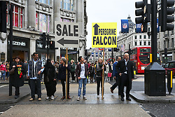PROJECT WILD THING. <br /> Shoppers in London's Oxford Street are reminded that among the bargains on offer is a free look at the world's fastest animal, which nests in buildings above their heads, London,  United Kingdom, Picture taken October 23, 2013. <br /> A new film releases nationwide with the message – GO OUTSIDE!<br /> PROJECT WILD THING, on general release from Friday 25 October, takes a funny, alarming and uplifting look at our disconnection from nature in the UK, and the retreat to an indoor, screen-based existence.<br /> Thursday, 24th October 2013. Picture by Hugo PhilPott / i-Images