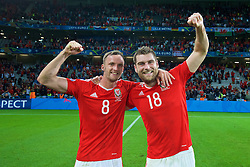 LILLE, FRANCE - Friday, July 1, 2016: Wales' goal-scorer Sam Vokes and team-mate Andy King celebrate after a 3-1 victory over Belgium and reaching the Semi-Final during the UEFA Euro 2016 Championship Quarter-Final match at the Stade Pierre Mauroy. (Pic by David Rawcliffe/Propaganda)