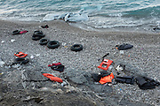 Life jackets and tyre inner tubes abandoned by refugees fleeing Syria having arrived on the Greek island of Chios. Some 800 refugees have been arriving daily on the island.