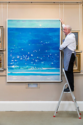 A selection of works from the Studio of the much-loved Scottish painter and teacher Alberto Morrocco will be included in the sale at Bonhams, 22 Queen Street, Edinburgh on Wednesday 29 November 2017 at 2pm<br /> <br /> Pictured: Bagni Miramare by Alberto Morrocco with Danny Mcilwraith from Bonhams