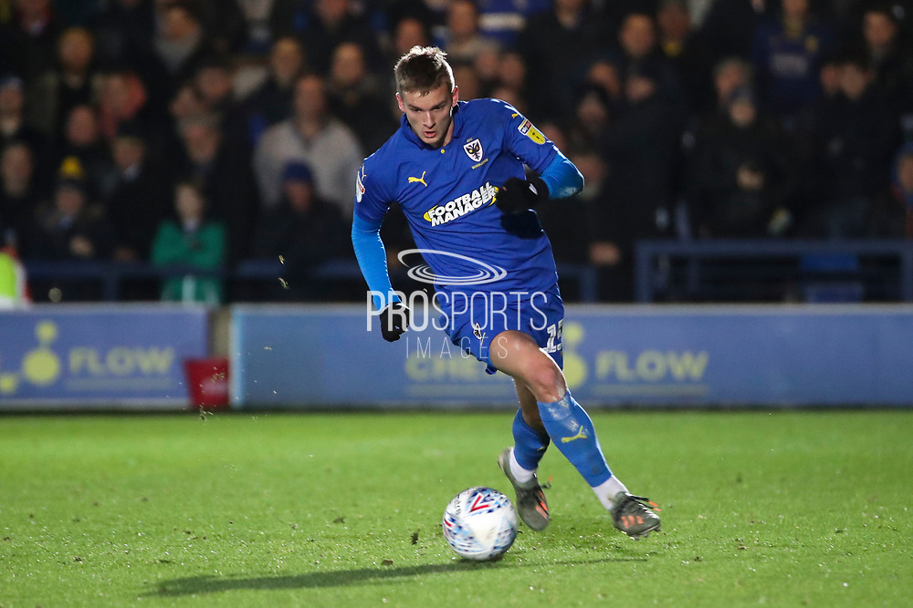 AFC Wimbledon attacker Marcus Forss (15) dribbling during the EFL Sky Bet League 1 match between AFC Wimbledon and Doncaster Rovers at the Cherry Red Records Stadium, Kingston, England on 14 December 2019.