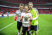 Michael Carrick Juan Mata of Manchester United and David De Gea of Manchester United with the FA cup during the The FA Cup Final between Crystal Palace and Manchester United at Wembley Stadium, London, England on 21 May 2016. Photo by Phil Duncan.