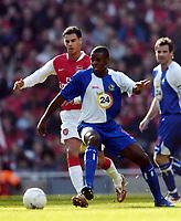 Photo: Olly Greenwood.<br />Arsenal v Blackburn Rovers. The FA Cup. 17/02/2007. Blackburn's Aaron Mokoena and Arsenal's Jeremie Aliadiere