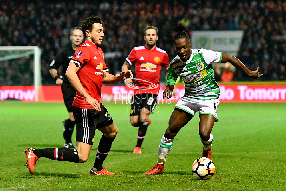 Jordan Green (15) of Yeovil Town is closed down by Matteo Darmian (36) of Manchester United during the The FA Cup 4th round match between Yeovil Town and Manchester United at Huish Park, Yeovil, England on 26 January 2018. Photo by Graham Hunt.
