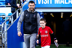 Bailey Wright of Bristol City with mascot - Mandatory by-line: Robbie Stephenson/JMP - 10/11/2019 -  FOOTBALL - Cardiff City Stadium - Cardiff, Wales -  Cardiff City v Bristol City - Sky Bet Championship