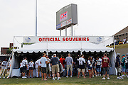 Fans line up to buy official souvenirs at a vendor stand prior to the NFL Pro Football Hall of Fame preseason football game between the Dallas Cowboys and the Cincinnati Bengals on Sunday, August 8, 2010 in Canton, Ohio. The Cowboys won the game 16-7. (©Paul Anthony Spinelli)