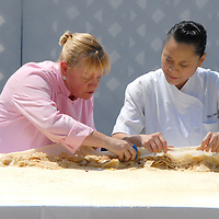 Pastry Chef from Spago Sherry Yard, (left) with Pastry chef Sally Camacho, demonstrates how to make an apple strudel during the Good Food Festival and Street Fair at Santa Monica High School on Saturday, September 17, 2011.