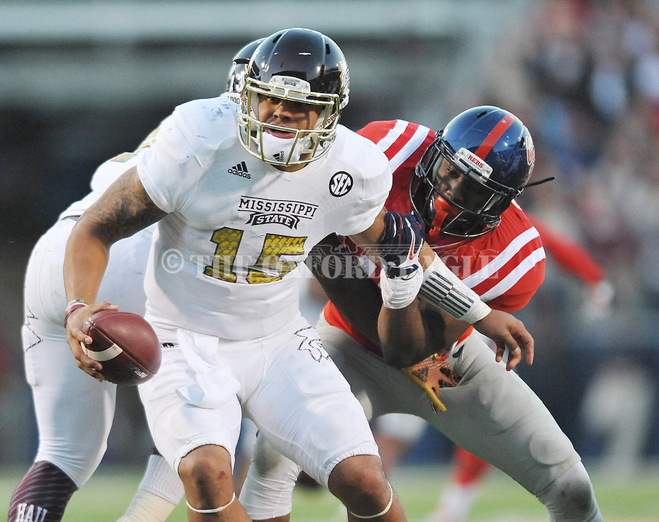 Ole Miss Rebels defensive back Tony Conner (12) sacks Mississippi State Bulldogs quarterback Dak Prescott (15) at Vaught-Hemingway Stadium in Oxford, Miss. on Saturday, November 29, 2014. Ole Miss won 31-17.