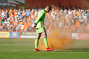 Dimitar Evtimov of Accrington looking at a flare thrown onto the pitch by Blackpool fans  during the EFL Sky Bet League 1 match between Accrington Stanley and Blackpool at the Fraser Eagle Stadium, Accrington, England on 21 September 2019.