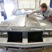 Thomas Wells | BUY at PHOTOS.DJOURNAL.COM<br /> Tupelo High School student Isaiah Mahaffey works on sanding the hood during his auto body repair class.