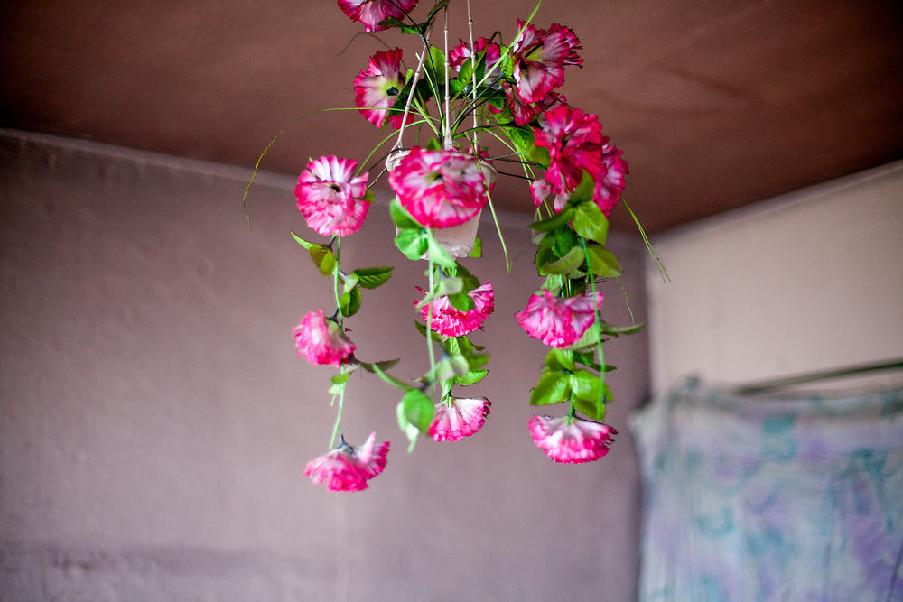 Artificial flowers hanging from the sealing in one flat at the Lunik IX housing estate in Kosice. The Lunik IX housing estate is home to the largest Roma community in Slovakia. It is located a few kilometers away from the historical city centre, on the outskirts of the eastern Slovakian city of Kosice. Since the beginning of the 1980s a large number of the Roma residents living in the city and in nearby settlements have been moved to Lunik IX.
