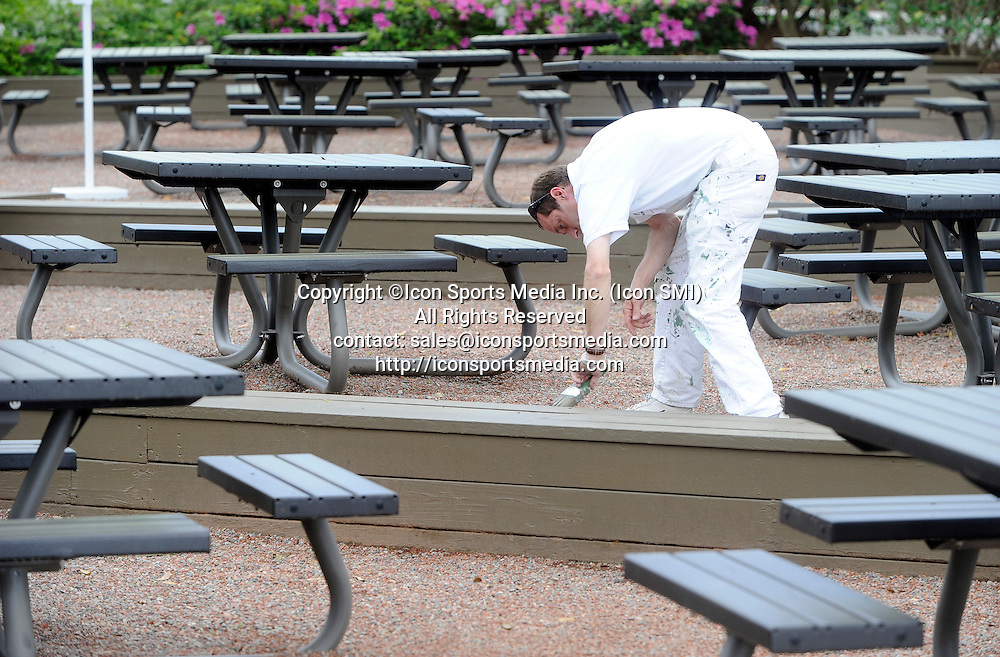 April 7, 2013 - Augusta, Georgia, U.S. - A painter puts the final touches on a bench, Sunday, April 7, 2013, in Augusta, GA.
