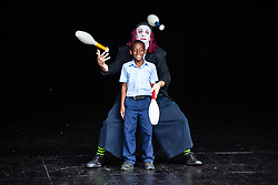 """Dash"" of Aga-Boom shows 3rd grade Yvonne Bowsky student LeAndre Finley how to juggle.  Aga-Boom performs at the Reichhold Center for the Arts on saturday night at 7pm.  Reichhold Center Family Series with the international comedy clown troupe Aga-Boom.  Reichhold Center.  9 November 2012.  © Aisha-Zakiya Boyd"