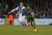 Bristol Rovers Joe Partington (22) battles for the ball against   Doncaster Rovers John Marquis (9) during the EFL Sky Bet League 1 match between Bristol Rovers and Doncaster Rovers at the Memorial Stadium, Bristol, England on 23 December 2017. Photo by Gary Learmonth.