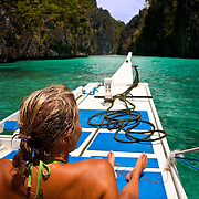 PALAWAN (Philippines). 2009. Girl on a boat at the Big Lagoon, near El Nido.
