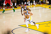 Golden State Warriors guard Stephen Curry (30) pushes the ball down the court against the Houston Rockets during Game 6 of the Western Conference Finals at Oracle Arena in Oakland, Calif., on May 26, 2018. (Stan Olszewski/Special to S.F. Examiner)