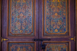 Detail of painted door panels on an old door in the Bahia Palace in Marrakech, Morocco, North Africa<br /> <br /> <br /> (c) Andrew Wilson | Edinburgh Elite media