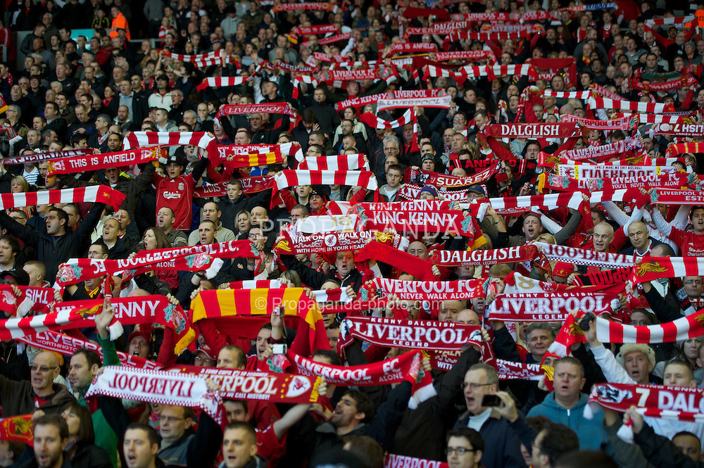 LIVERPOOL, ENGLAND - Saturday, February 12, 2011: Liverpool supporters on the Spion Kop hold their scarves aloft as they sing 'You'll Never Walk Alone' during the Premiership match against Wigan Athletic at Anfield. (Photo by David Rawcliffe/Propaganda)