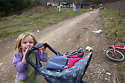 Amy Lumpkins, 5, playting outside her family trailer home.. Her family is deep in poverty living in the Appalachian mountains of Eastern Kentucky near the town of Mousie.