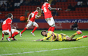 Charlton Athletic defender Harry Lennon gets in a vital tackle against Nottingham Forest forward Ryan Mendes who knows it was a great chance during the Sky Bet Championship match between Charlton Athletic and Nottingham Forest at The Valley, London, England on 2 January 2016. Photo by Andy Walter.