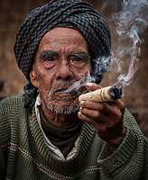 BAGAN, MYANMAR - CIRCA DECEMBER 2017: Old man from a village around Bagan moking.