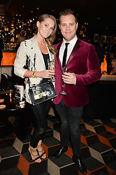 JUDE CISSE and KIERAN JAE at a party to celebrate the publication of Behind The Mask by Emma Sayle held at The Playboy Club, 14 Old Park Lane, London on 23rd April 2014.