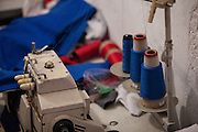 Sewing machine and spools of blue cotton.
