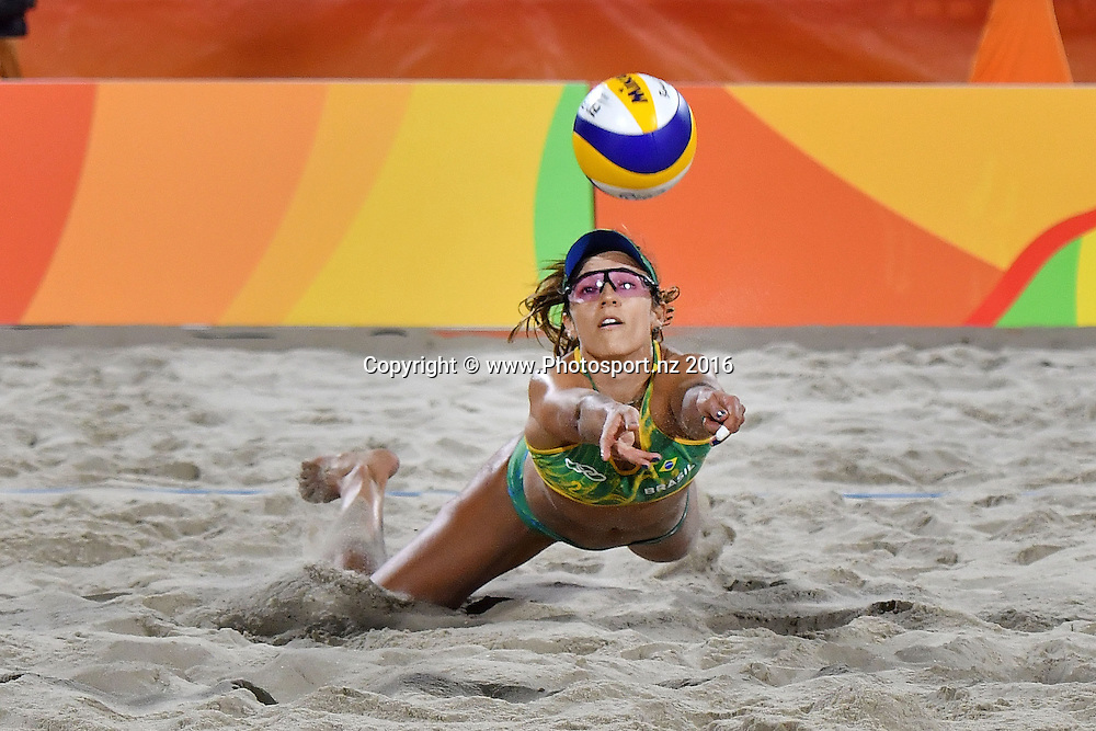 Brazil's Agatha Bednarczuk-Rippel dives to return the ball during the Women's beach Volleyball semifinal in the volleyball arena on Copacabana beach at the 2016 Rio Olympics on Wednesday the 17th of August 2016. © Copyright Photo by Marty Melville / www.Photosport.nz