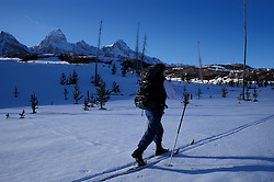 Tagart Lake Trail, Grand Teton N.P., WY.Cross-country skiing in front of the Tetons