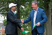 Roderick McDavis, President of Ohio University, left, and Mayor Steve Patterson of Athens, Ohio, officially reopen Ohio University's newly-renovated College Gateway on October 8, 2016.