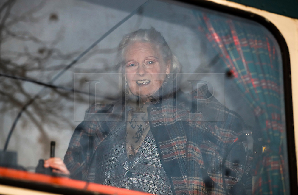 "© Licensed to London News Pictures. 26/11/2016. London, UK. DAME VIVIENNE WESTWOOD watches from a bus. Joe Corre, the son of former Sex Pistol manager Malcolm McLaren and Vivienne Westwood burns his personal collection of Sex Pistols punk memorabilia. Earlier this week Joe Corre said that punk has become nothing more than a ""McDonald's brand ... owned by the state, establishment and corporations"". His collection is estimated to be worth £5 million. Photo credit: Peter Macdiarmid/LNP"