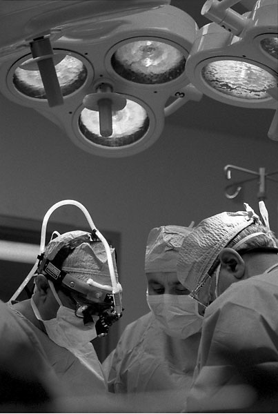 Stock photo of doctors performing surgery