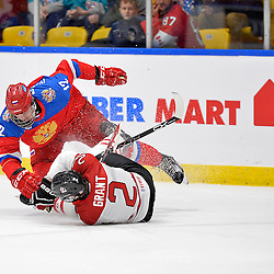 WHITBY, - Dec 14, 2015 -  Game #4 - Russia vs. Canada East at the 2015 World Junior A Challenge at the Iroquois Park Recreation Complex, ON. Artem Ivanyuzhenkov #12 of Team Russia makes the hit on Owen Grant #2 of Team Canada East during the first period.<br /> (Photo: Shawn Muir / OJHL Images)