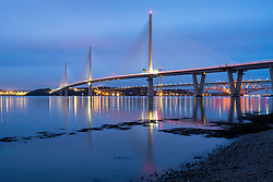 Night view of new Queensferry Crossing Bridge spanning the River Forth in Scotland, United Kingdom